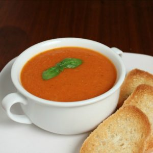 This traditional homemade tomato basil soup recipe can be served home style by pairing with a grilled cheese sandwich or with a sophisticated twist by changing up your garnishes.