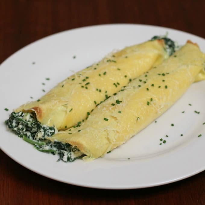 Spinach and Ricotta Crepes are rich, savory and an elegant dinner entree for that special occasion